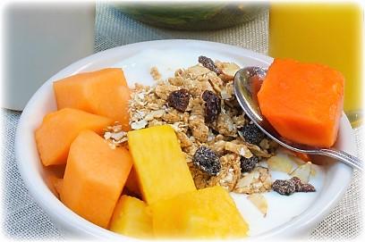 Fresh tropical fruit with yogurt and granola